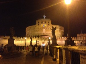 I love how one of the angel statues from the bridge is silhouetted against the castle in this photo.