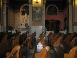 The pew from which a character gazes at the painting