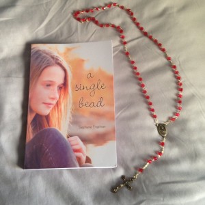 A Single Bead by Stephanie Engelman and my mom's St. Therese of Lisieux rosary
