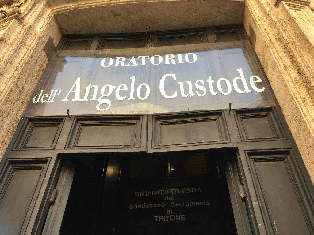 """Angelo Custode"" means ""Guardian Angel"" in Italian. :)"